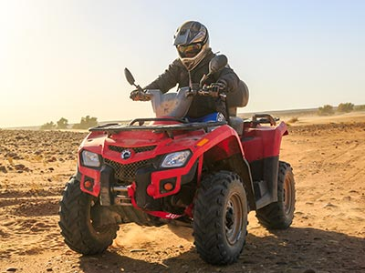 Person on a red ATV in the dirt