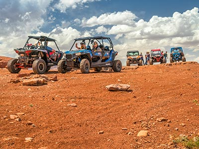 People on ATVs in the desert