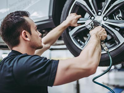 Man working on car in auto shop