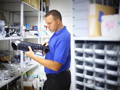 Man organizing auto parts