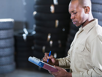 Man reviewing inventory at auto parts store