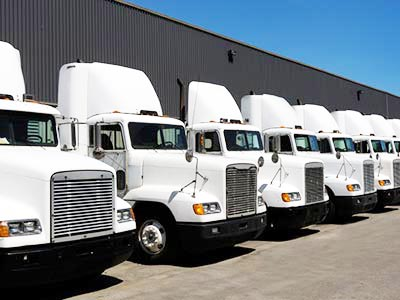 Line of trucks at warehouse