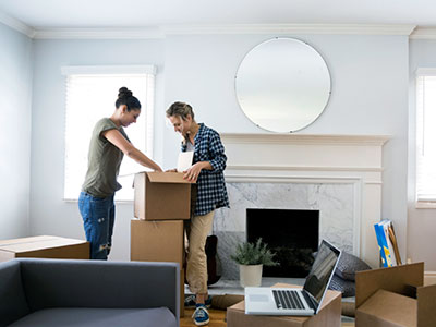 Man and woman unpacking boxes in a new home