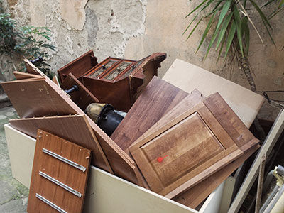 Junk collection of furniture pieces out for pick up