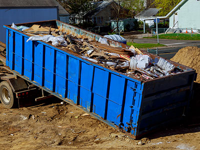 Blue open top trailer filled with junk