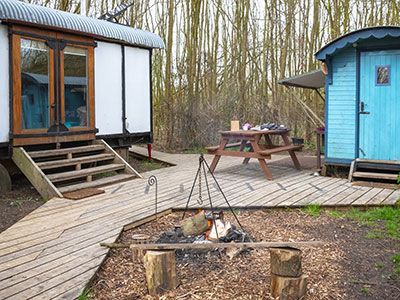 Tiny home trailer homes by a fire