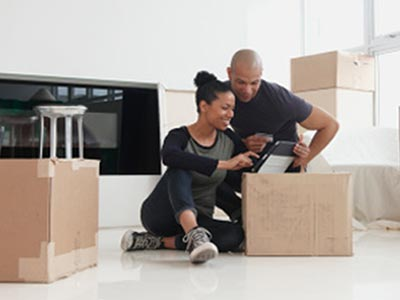 Two people unpacking after their move