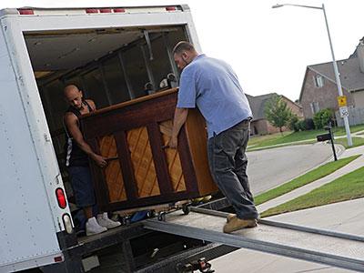 Piano movers delivering a piano