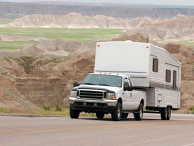 White truck hauling travel trailer