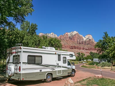 Fifth-wheel parked in an RV park near desert mountains