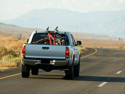 Bikes in the back of a truck on the road