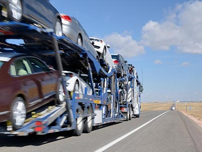 Double decker car carrier delivering vehicles