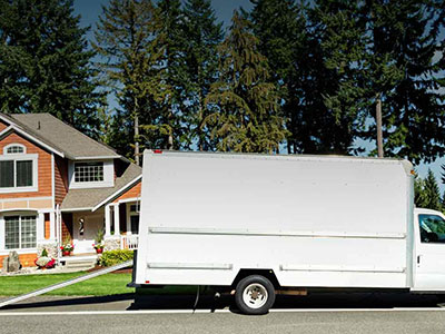 White glove moving truck in front of a home